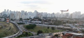 An airplane prepares to land over a jammed highway during a normal weekday at Congonhas Airport, Sao Paulo